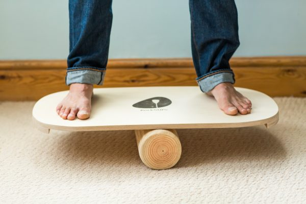 Standing on balance board